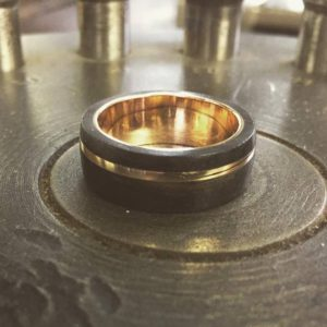 Wooden ring (Exquisite ring with ebony wood and gold in lay)